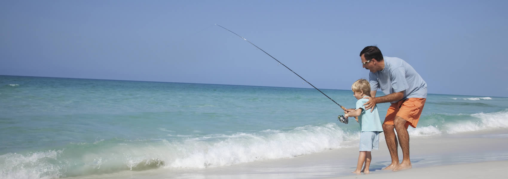 Father & son fishing on the beach