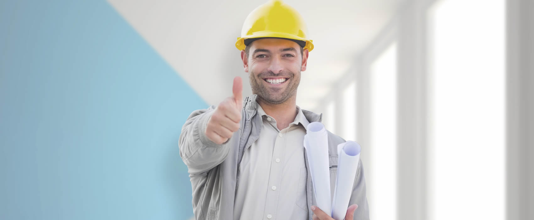 Man in hard hat giving the thumbs-up